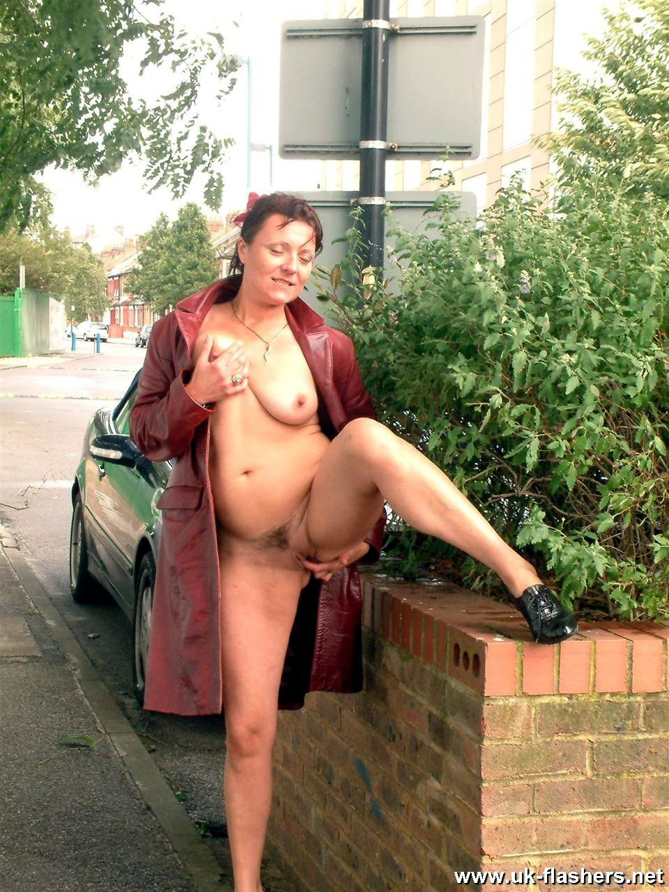 Public mature nude woman